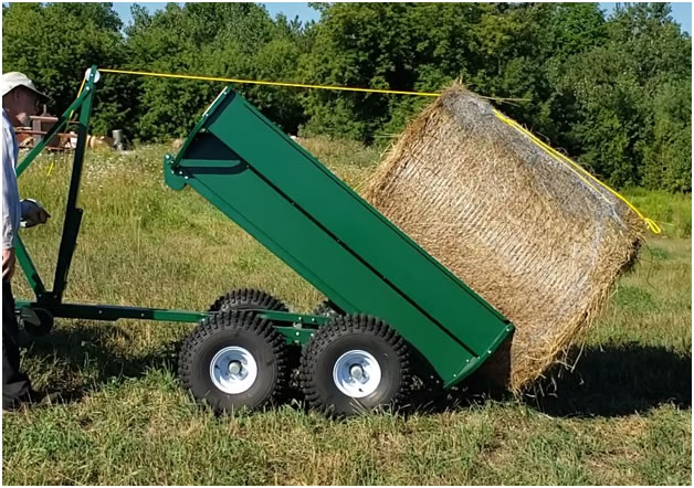 MUTS ATV/ UTV side by side utility trailer loading a round hay bale
